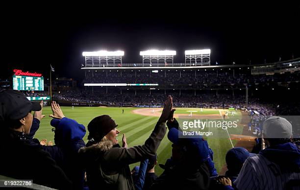 Fans cheer during Game 5 of the 2016 World Series between the Cleveland Indians and the Chicago Cubs at Wrigley Field on Sunday October 30 2016 in...