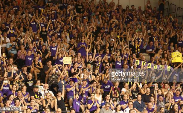 Fans cheer during game two of the WNBL Grand Final series between the Melbourne Boomers and the Townsville Fire at the State Basketball Centre on...