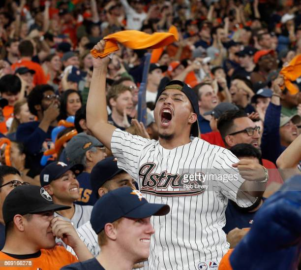 Fans cheer during Houston Astros Game 7 World Series watch party on November 1 2017 in Houston Texas