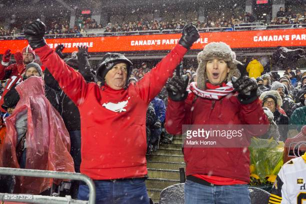 Fans cheer during the 105th Grey Cup Championship Game between the Calgary Stampeders and the Toronto Argonauts at TD Place Stadium on November 26...
