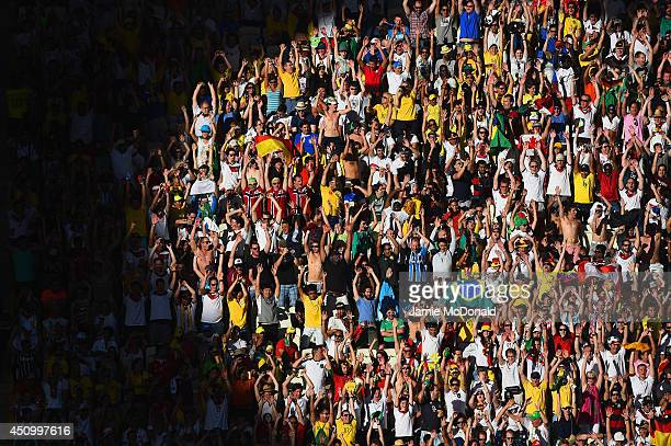 Fans cheer during the 2014 FIFA World Cup Brazil Group G match between Germany and Ghana at Castelao on June 21 2014 in Fortaleza Brazil