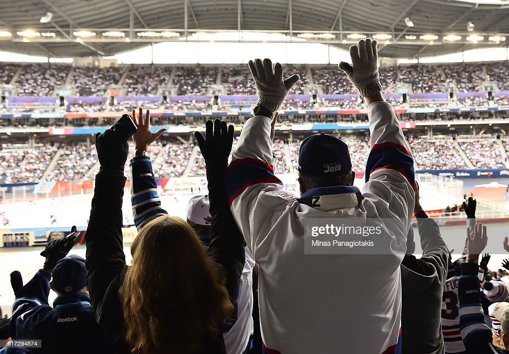 Fans cheer during the 2016 Tim Hortons NHL Heritage Classic alumni game at Investors Group Field on October 22, 2016 in Winnipeg, Canada.