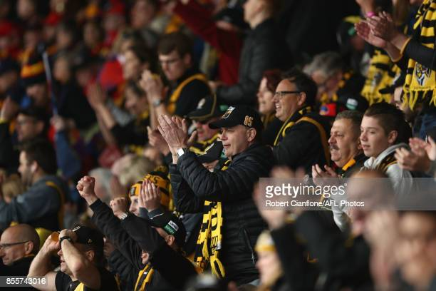 Fans cheer during the 2017 AFL Grand Final match between the Adelaide Crows and the Richmond Tigers at Melbourne Cricket Ground on September 30 2017...