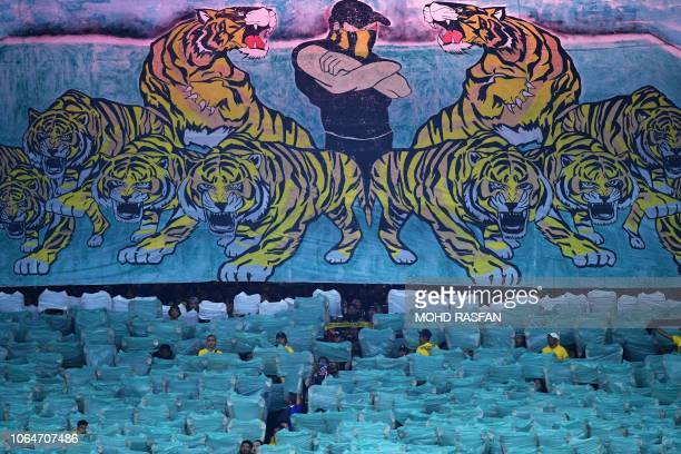 Fans cheer during the AFF Suzuki Cup 2018 football match between Malaysia and Myanmar at the Bukit Jalil National Stadium in Kuala Lumpur on November...