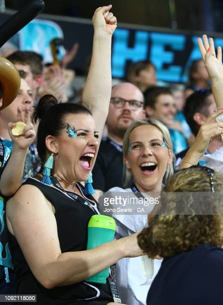 Fans cheer during the Big Bash League match between the Brisbane Heat and the Melbourne Renegades at The Gabba on January 10 2019 in Brisbane...
