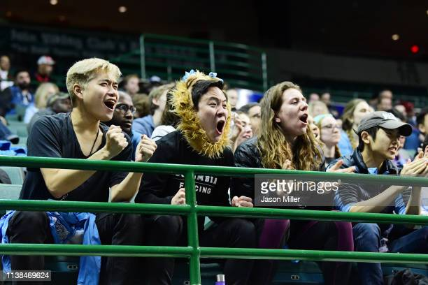 Fans cheer during the bout between Andrea Vittoria Rizzi of St John's and Anne Cebula of Columbia during the Division I Women's Fencing Championship...
