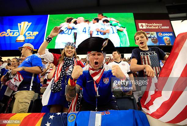 USA fans cheer during the CONCACAF Gold Cup match between Panama and the United States at Sporting Park on July 13 2015 in Kansas City Kansas