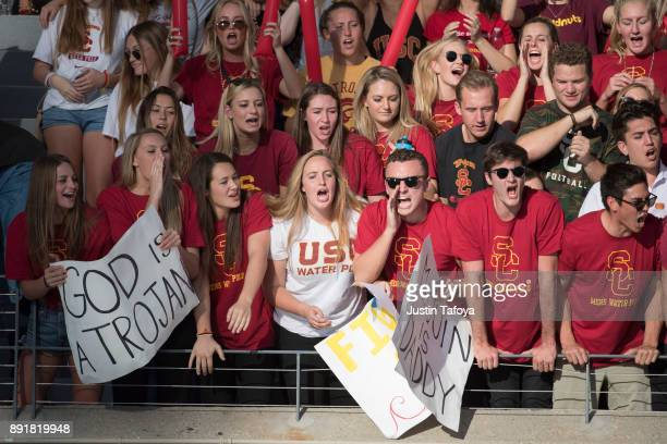 Fans cheer during the Division I Men's Water Polo Championship held at the Uytengsu Aquatics Center on the University of Southern California campus...