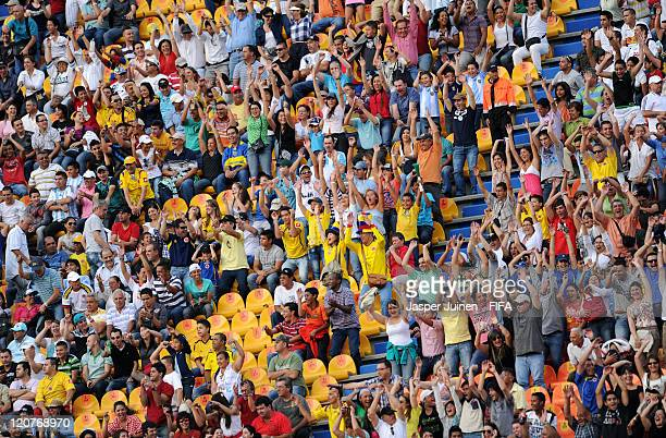 Fans cheer during the FIFA U20 World Cup Colombia 2011 round of 16 match between Argentina and Egypt at the Atanasio Girardot stadium on August 9...