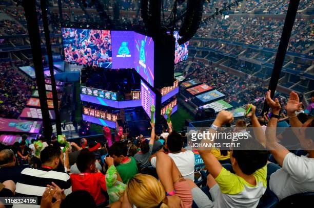 Fans cheer during the final of the Solo competition at the 2019 Fortnite World Cup July 28 2019 inside of Arthur Ashe Stadium in New York City