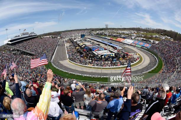 Fans cheer during the flyover before the Monster Energy NASCAR Cup Series STP 500 at Martinsville Speedway on April 2 2017 in Martinsville Virginia