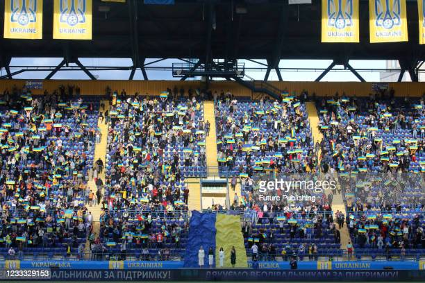 Fans cheer during the friendly match between the national teams of Ukraine and Cyprus which resulted in a home win 4:0 at the Matalist Regional...