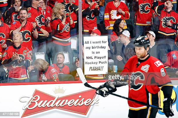 Fans cheer during the game between the Calgary Flames and the Vancouver Canucks at Scotiabank Saddledome for Game Six of the Western Quarterfinals...