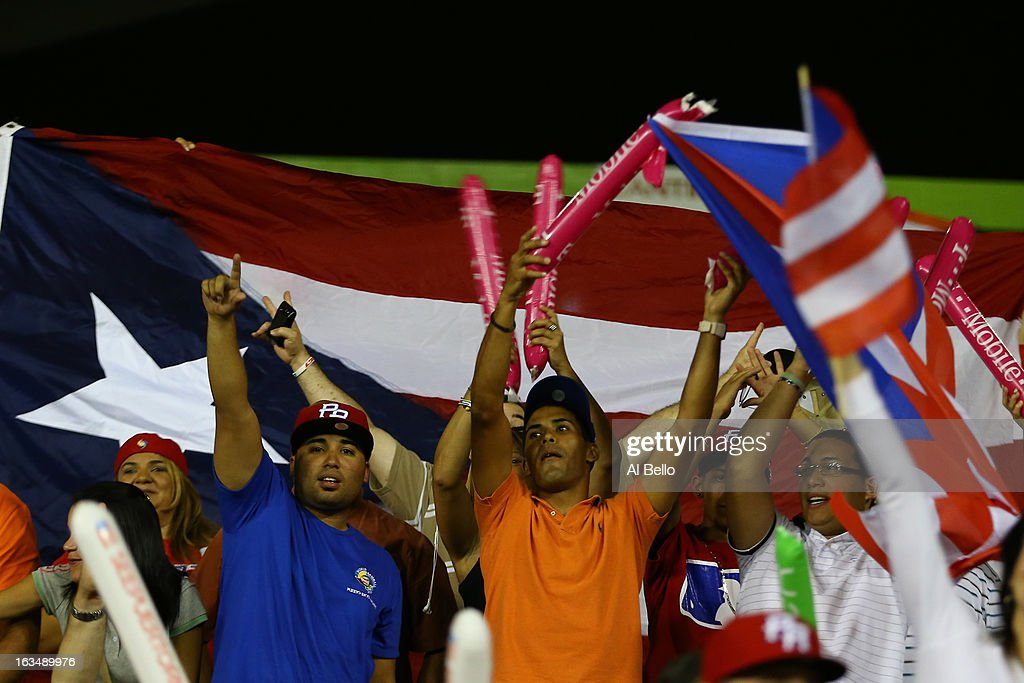 Fans cheer during the game between the Dominican Republic and Puerto Rico during the first round of the World Baseball Classic at Hiram Bithorn Stadium on March 10, 2013 in San Juan, Puerto Rico.