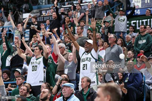 Fans cheer during the game between the Milwaukee Bucks and the Toronto Raptors in Game Four during the Eastern Conference Quarterfinals of the 2017...