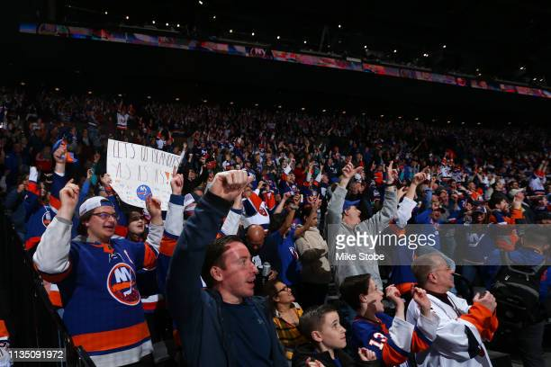 Fans cheer during the game between the New York Islanders and the Buffalo Sabres at NYCB Live's Nassau Coliseum on March 30 2019 in Uniondale New...