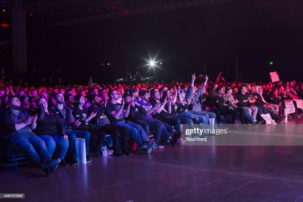 Fans cheer during the grand final game between teams Tox and Splyce at the Halo World Championship finals in Seattle, Washington, U.S., on Sunday, April 15, 2018. E-sports revenue, consisting of merchandise, event tickets, sponsorships, advertising and media rights -- all beyond game sales -- is expected to rise at a 32.2% average annual rate in 2016-20 to $1.5 billion in 2020, according to Newzoo. Photographer: David Ryder/Bloomberg via Getty Images