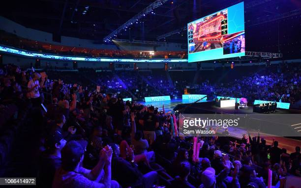 Fans cheer during the grand finals match of the Rocket League Championship Series World Championship between team Dignitas and team Cloud9 at the...