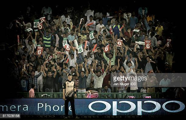 Fans cheer during the ICC World Twenty20 India 2016 Super 10s Group 2 match between New Zealand and Pakistan at the IS Bindra Stadium on March 22...