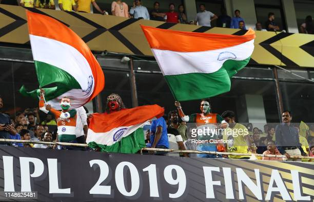 Fans cheer during the Indian Premier League Final match between the the Mumbai Indians and Chennai Super Kings at Rajiv Gandhi International Cricket...