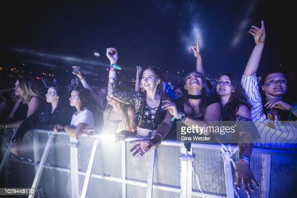 Fans cheer during the Lollapalooza festival at the Olympiagelände on September 8 2018 in Berlin Germany