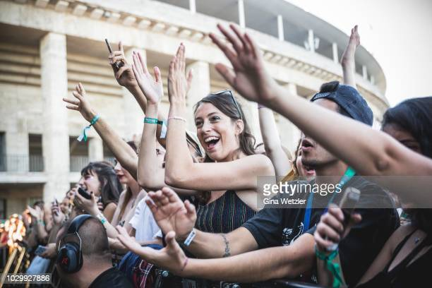 Fans cheer during the Lollapalooza festival at the Olympiagelände on September 9, 2018 in Berlin, Germany.