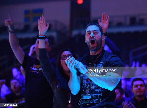 Fans cheer during the lower bracket finals match of the Rocket League Championship Series World Championship between team Cloud9 and team We Dem...