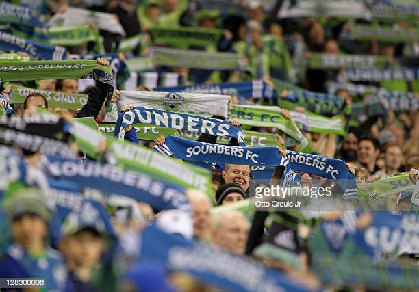 Fans cheer during the match between the Seattle Sounders FC and the Chicago Fire in the 2011 Lamar Hunt US Open Cup Final at CenturyLink Field on...