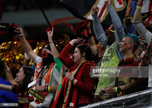 Fans cheer during the MLS Eastern Conference Finals between Atlanta United and the New York Red Bulls at MercedesBenz Stadium on November 25 2018 in...