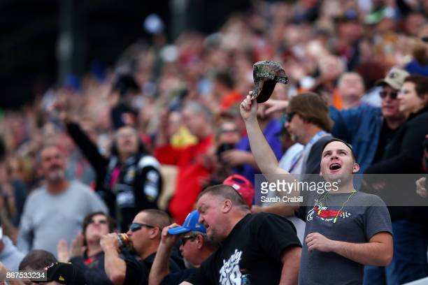 Fans cheer during the NASCAR Camping World Truck Series Texas Roadhouse 200 at Martinsville Speedway on October 28 2017 in Martinsville Virginia