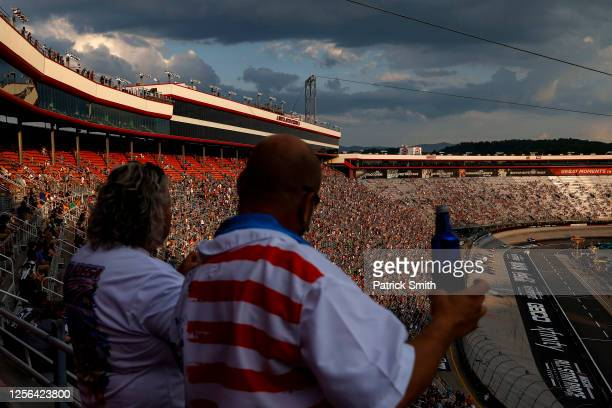 Fans cheer during the NASCAR Cup Series AllStar Race at Bristol Motor Speedway on July 15 2020 in Bristol Tennessee The NASCAR AllStar Race was moved...