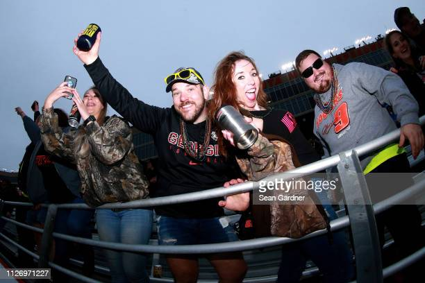 Fans cheer during the NASCAR Gander Outdoors Truck Series Ultimate Tailgating 200 at Atlanta Motor Speedway on February 23 2019 in Hampton Georgia