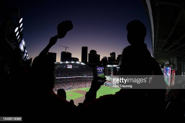 Fans cheer during the national anthem ahead of Game Two of the World Series between the Atlanta Braves and the Houston Astros at Minute Maid Park on...