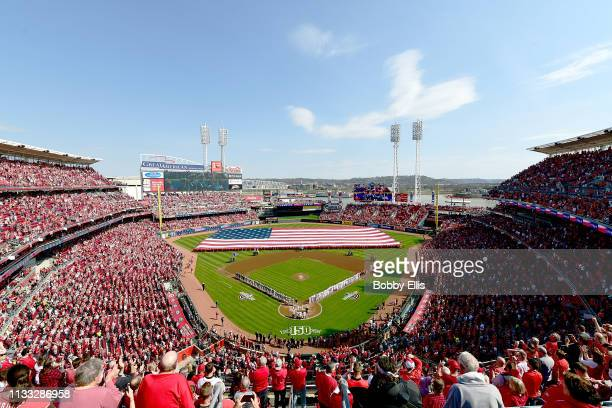 Fans cheer during the National Anthem on Opening Day between the Pittsburgh Pirates and the Cincinnati Reds at Great American Ball Park on March 28...