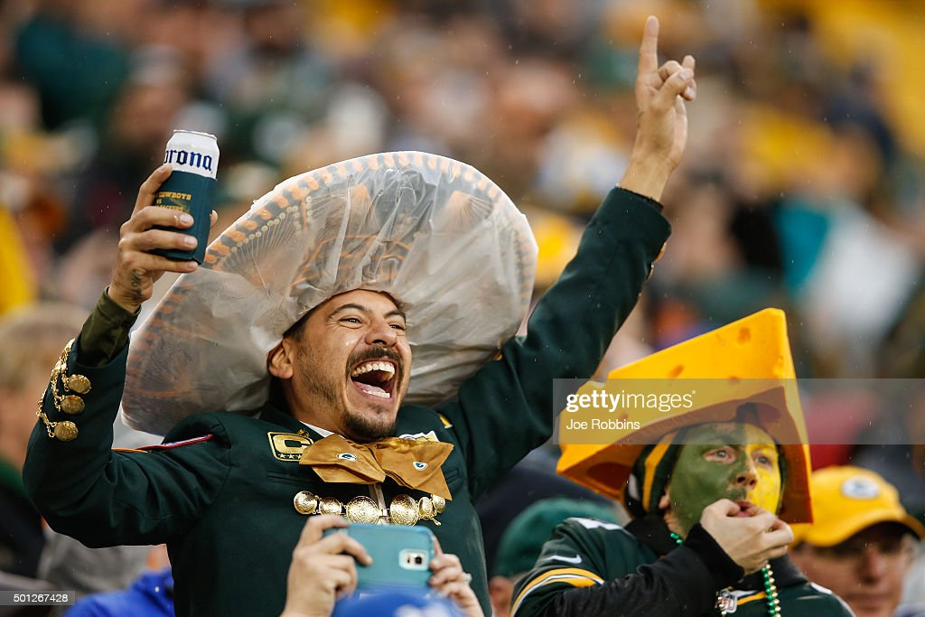 Fans cheer during the NFL game between the Dallas Cowboys and the Green Bay Packers at Lambeau Field on December 13, 2015 in Green Bay, Wisconsin. The Green Bay Packers defeated the Dallas Cowboys 28 to 7.