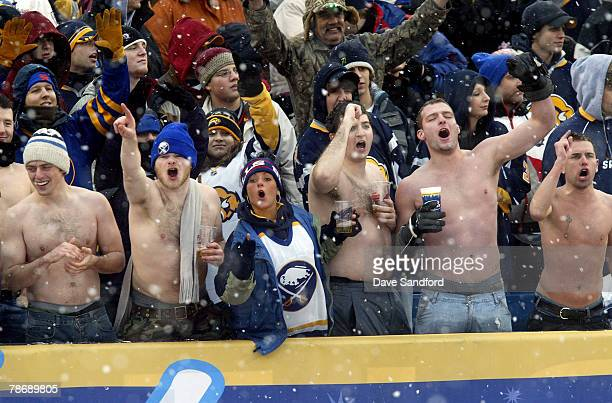 Fans cheer during the NHL Winter Classic between the Buffalo Sabres and the Pittsburgh Penguins at the Ralph Wilson Stadium on January 1 2008 in...