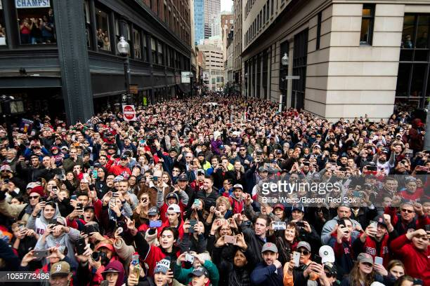 Fans cheer during the of the Boston Red Sox 2018 World Series rolling rally parade on October 31 2018 in Boston Massachusetts