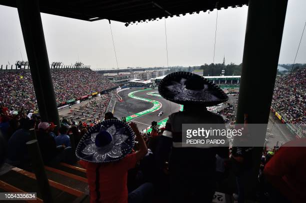 TOPSHOT Fans cheer during the qualifying session of the F1 Mexico Grand Prix at the Hermanos Rodriguez circuit in Mexico City on October 27 2018...