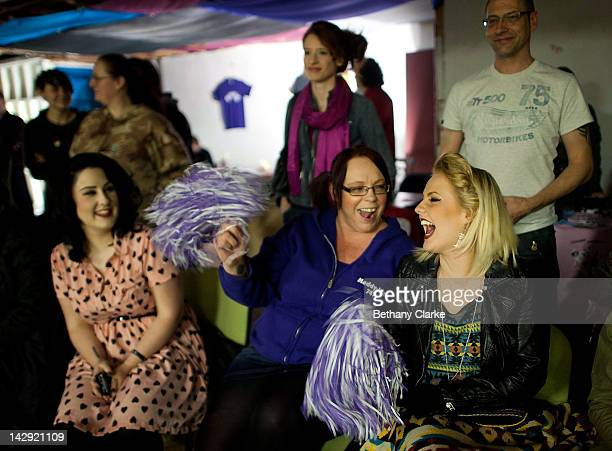 Fans cheer during the Rollergirls Roller Derby event on April 14 2012 in Oldham England The contact sport of Roller Derby involves two teams of four...