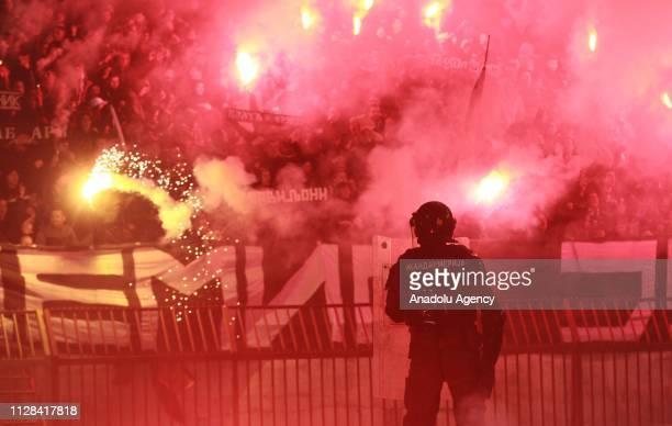 Fans cheer during the Serbian Super Liga week 24 soccer match between Crvena Zvezda and Partizan at the Rajko Mitic Stadium in Belgrade, Serbia on...