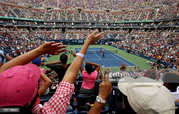Fans cheer during the Stadium Show on Arthur Ashe Kids' Day prior to the start of the 2012 US Open at the USTA Billie Jean King National Tennis...