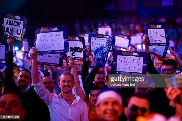 Fans cheer during the third round match between Mensur Suljovic of Austriaand Adrian Lewis of England on Day Eleven of the 2016 William Hill PDC...