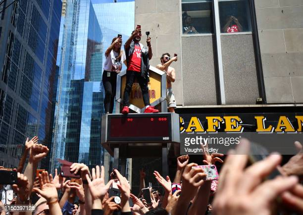 Fans cheer during the Toronto Raptors Victory Parade on June 17 2019 in Toronto Canada The Toronto Raptors beat the Golden State Warriors 42 to win...