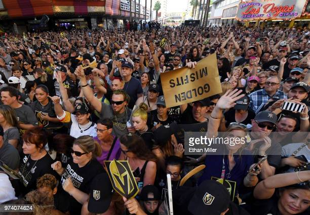 Fans cheer during the Vegas Golden Knights' 'Stick Salute to Vegas and Our Fans' event at the Fremont Street Experience on June 13 2018 in Las Vegas...