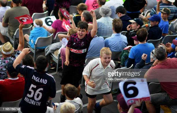 Fans cheer during the Vitality Blast match between Somerset and Surrey at The Cooper Associates County Ground on August 02, 2019 in Taunton, England.