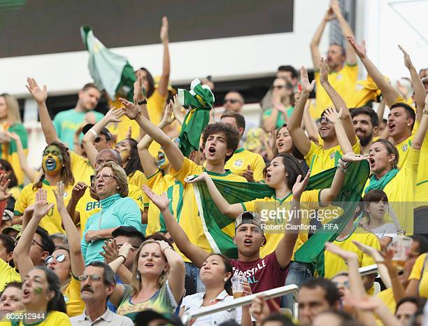 Fans cheer during the Women's Football Bronze Medal match between Brazil and Canada on Day 14 of the Rio 2016 Olympic Games at Arena Corinthians on...
