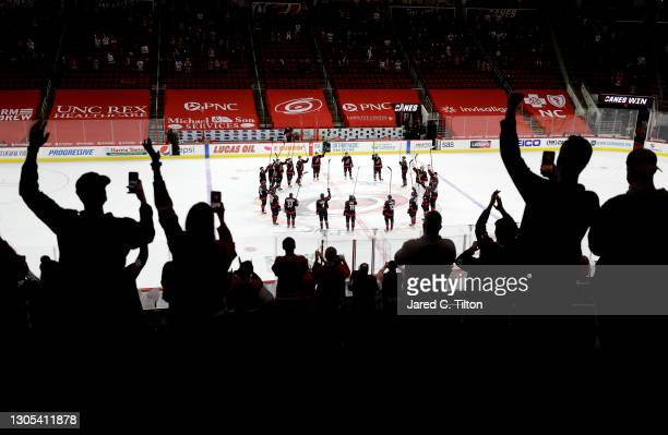 Fans cheer following the Carolina Hurricanes' 5-2 victory over the Detroit Red Wings at PNC Arena on March 04, 2021 in Raleigh, North Carolina.