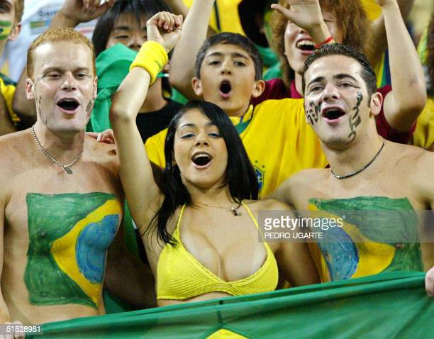 Fans cheer for Brazil in Saitama Stadium Japan 26 June before the start of the BrazilTurkey semifinal match of the FIFA 2002 World Cup Korea Japan...