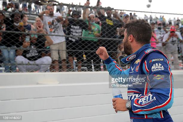 Fans cheer for Bubba Wallace driver of the Victory Junction Chevrolet after the NASCAR Cup Series GEICO 500 at Talladega Superspeedway on June 22...