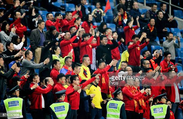 Fans cheer for China National Team during the international friendly match between China and Columbia at Chongqing Olympic Sports Centre on November...